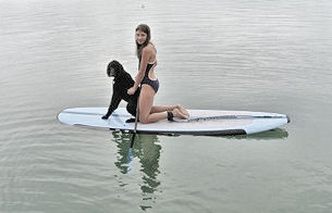 Jake enjoys paddle board with some gentle coaxing