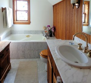 oak and marble bathroom